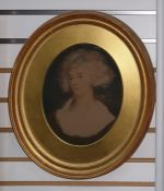 Pair of coloured prints, within oval gilt frames, showing late 18th century portraits of ladies,