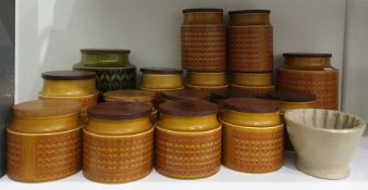 Large collection of Hornsea 'Saffron' pattern pottery storage jars, cylindrical, with wooden covers,