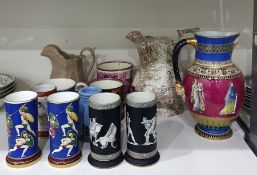Two various pairs of cylindrical ceramic spill vases with classical figure decoration, a similar