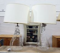 Pair of clear glass bodied table lamps, cream shades
