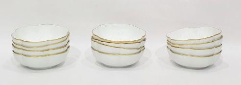 Set of twelve Raynaud Limoges white porcelain lobed dessert bowls, gilt bordered