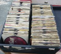 Case of 45rpm singles to include examples by ACDC, Adam and the Ants, The Banned, The Beatles, The