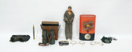 Assorted collectablesto include Tennis balls, glasses, binoculars, etc and a action manCondition