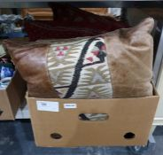 Pair of hide and kelim patch cushions with corduro