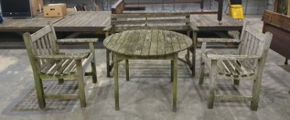 Garden furniture to include bench, two chairs and circular table