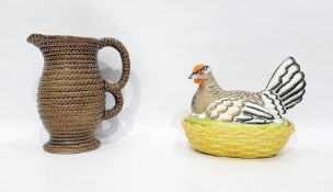 Pottery bowl and cover in the form of hen on basket, having yellow osier-pattern base, 16cm wide and