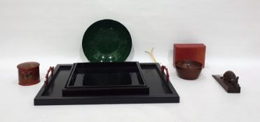 Collection of Oriental black lacquered trays with red branch handles, a green and black mottled