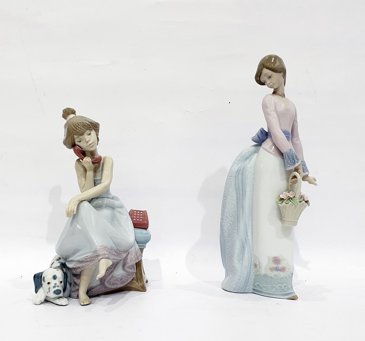 Lot 38 - Lladro porcelain figure of a girl with basket and a Lladro porcelain figure of girl with telephone