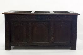 18th century oak cofferwith three carved arched panels to the front, on stile supports