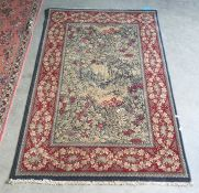 Modern rug, the central field with wooded landscape scene, red ground foliate decorated border