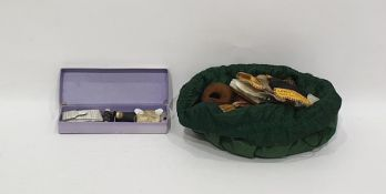 Various sewing implements, including vintage thread tools, scissors and other items, all in a