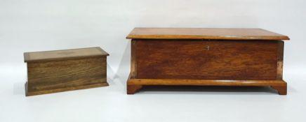 Oak box raised on bracket feet and an oak and inlaid tea caddy(2)