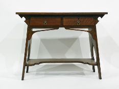 Early 20th century oak Arts & Crafts desk, the rectangular top above two drawers, supported by