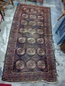 Belouch rug, blue ground, central field with 21 elephant foot guls interspersed with diamond
