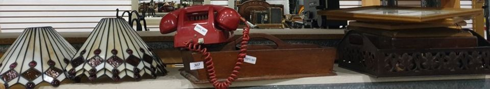 Red plastic dial telephone, three Tiffany style lampshades, wooden cutlery tray, assorted prints,