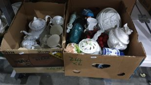 Six boxes of china and glassware to include large brandy balloon, decanters, vases, plant pot