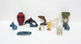 Poole Pottery model dolphin, two Poole Pottery model otters, two Poole Pottery vases, various, and a