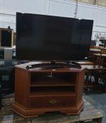 """LG 43"""" Ultra HD Smart TV, model No. 43UJ634V on wood effect TV stand"""