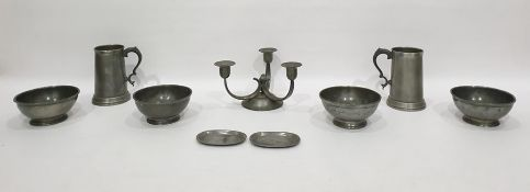 Various pewter itemsincluding two tankards with glass bases, a three-branch candelabraof Arts &