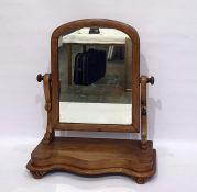 19th century mahogany dressing table mirror, the arched top mirror on a serpentine fronted base