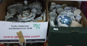 Four boxes of assorted ceramics to include commemorative mugs, a rabbit jelly mould, other plates