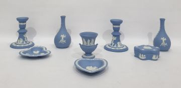 Various blue jasperware Wedgwood items,including pair of candlesticks, pair posy vases, two pin