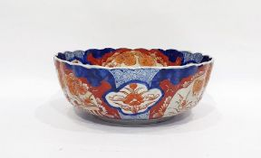 Japanese Imari fluted circular bowl, the interior painted with a jardiniere of flowers on a terrace,