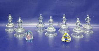 Set of seven glass inverse bell-shaped candle holderswith a single gilt metal wall bracket and