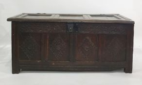 Possibly 17th century oak cofferwith four diamond carved panels to the front, with iron lock and