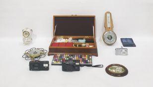 Various barometers, ceramic clock, Olympus camera, Kodak box camera, wooden sewing boxinlaid,
