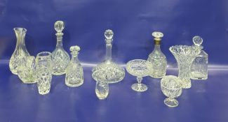 Cut glass spirit decanter, club-shaped with silver mounted neck and the cut mushroom-shaped stopper,