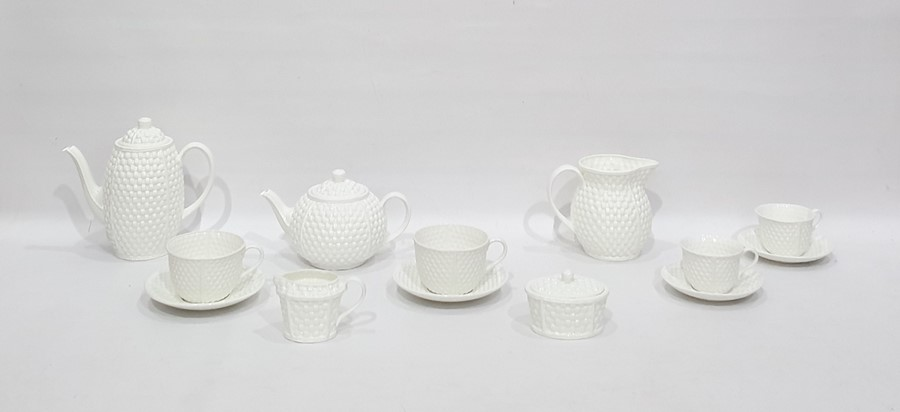 """Lot 39 - Tiffany porcelain part breakfast/tea service""""Tiffany Weave"""" pattern, undecorated, with 10 variously"""