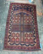 Eastern rug - blue ground, stepped border in blues, reds, browns and greens 152 x 92 cms