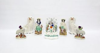 Pair 19th century Staffordshire pottery model spaniels, Staffordshire pottery group of lovers in