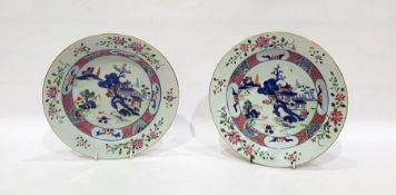 Pair of Chinese porcelain plates, each with lakeside landscape to centre and famille rose type