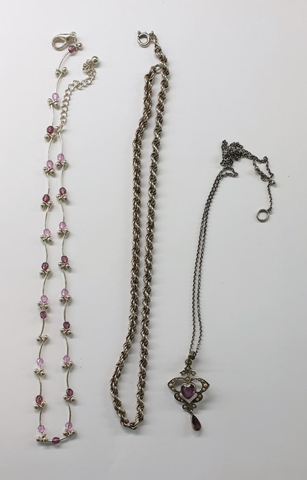 Lot 399 - Silver, amethyst and seedpearl pendantwith chain link necklace, a silver ropetwist pattern chain
