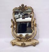 Dressing table swing mirror in the rococo taste, the whole surmounted by cherub, all painted cream