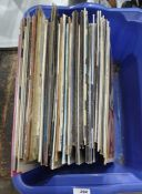 Box of vinyl LP's from the 80's including Simply Red, The Eurythmics, The House Martins, etc.