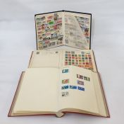 Three stock bookswith commonwealth stamps from George V and other world stamps and12 stock books