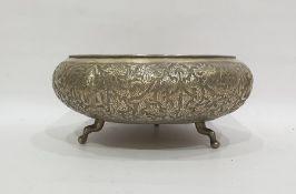 Eastern white metal circular bowl, with foliate surround, raised on cabriole feet, 25cm diameter,