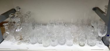 Six various cut glass decantersand a large quantity of cut drinking glassesto include goblets,