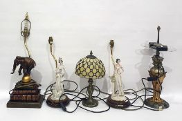Quantity of table lampsincluding faux-books on a stand with a resin elephant balancing on a
