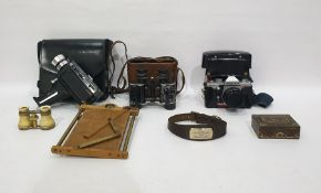 Bell & Howell Auto Load Cine Camerain leather carry case, a pair of binoculars, a Pentagon
