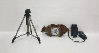 Wall clockwith a Delft tile face, brass pediment and assorted camera equipment