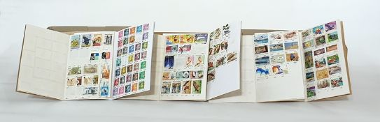 Quantity of partly filled approval bookswith stamps of many countries and unused stock cards, a box