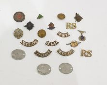 Two boxes of assorted collectables and small itemsto include military badges, glove stretcher,