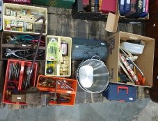Nine various boxes containing tools and hardware including pliers, wrenches, punches, saws, files