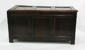 18th century oak cofferwith three panelled lid and front, on stile supports
