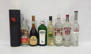 Eight bottles of assorted alcoholto include Tequilla, Tokaji Szu, three Puttonyos, Lubuski gin