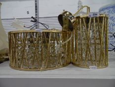 Two gilt metal graduated drum-shaped light fittingswith cut glass prismatic drops (2)